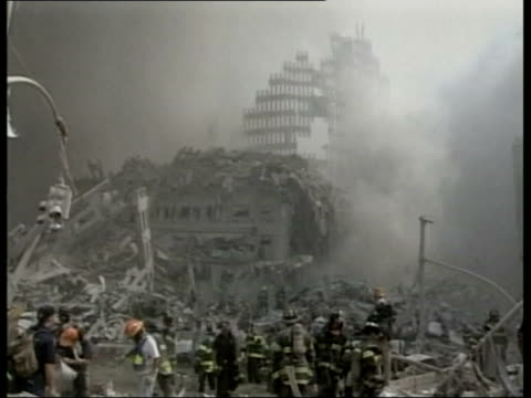 lib usa new york manhattan emnergency services around smoking remains of the world trade center after terrorist attack rescue workers amidst rubble... - world trade center manhattan video stock e b–roll