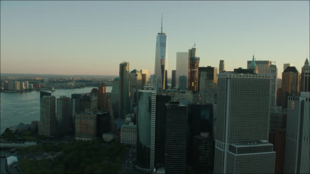 new york manhattan sunrise 4k aerial wall street downtown view of freedom tower - 2016 stock videos and b-roll footage