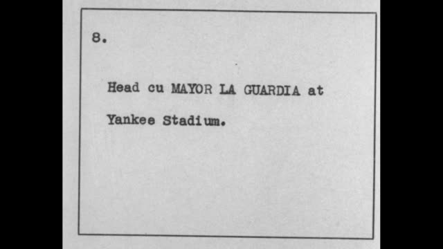 new york mayor fiorello la guardia wears fedora at yankee stadium / another man in a hat / note exact day/month not known - fiorello la guardia stock videos & royalty-free footage
