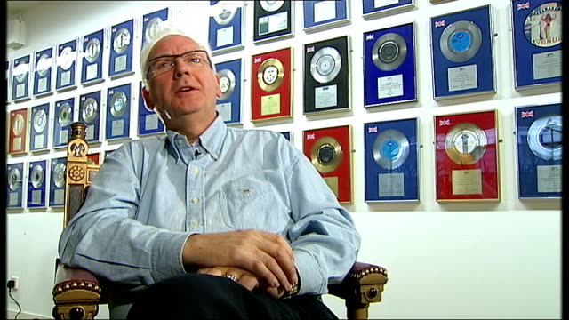 New York Mets fall victim to Rick Astley Internet prank ENGLAND London INT Framed platimum gold and silver discs on wall of PWL studio offices Gold...