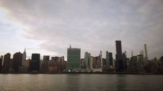 new york midtown skscrapers skyline with united nations - east river stock videos & royalty-free footage
