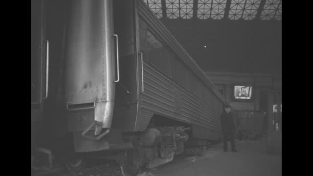 vidéos et rushes de new york new haven and hartford sign on the side of a wrecked passenger car with a worker sweeping debris and pan to collapsed structure / passenger... - passenger train
