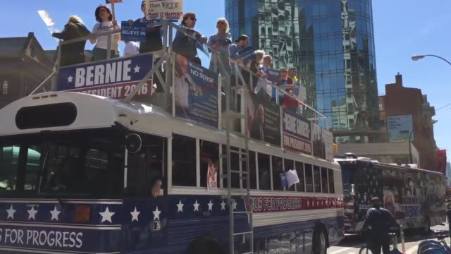"""vídeos de stock, filmes e b-roll de bernie sanders ride buses holding signs shouting: """"fight for jobs and education not mass incarceration!"""" bernie sanders supporters shouting """"this is... - bernie sanders"""