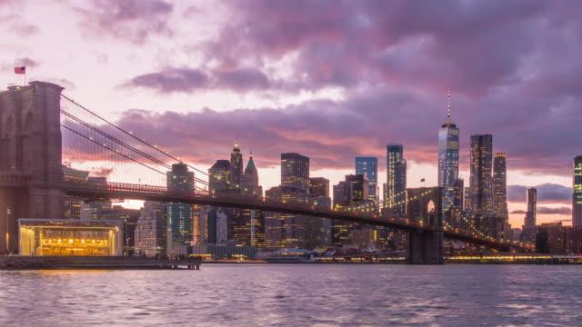new york, new york, usa skyline of manhattan on the east river with brooklyn bridge - brooklyn bridge stock videos & royalty-free footage