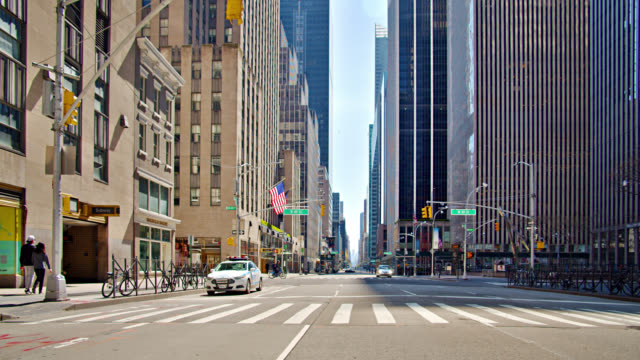 new york police car on an empty american 6th avenue during the self isolation, lockdown. - recovery stock videos & royalty-free footage