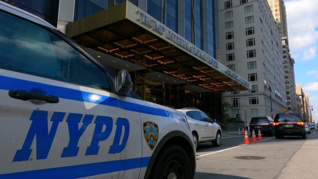 stockvideo's en b-roll-footage met new york police department vehicle sits parked outside the central park west entrance of trump international hotel on september 28, 2020. - redactioneel