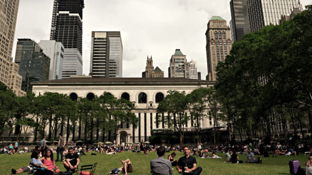 new york public library. people at leisure at bryant park. financial district. business and pleasure. - bryant park stock videos & royalty-free footage