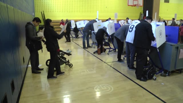 stockvideo's en b-roll-footage met new york residents cast their ballots at a polling station during the 2016 presidential elections in new york city on november 8 2016 americans... - stembus