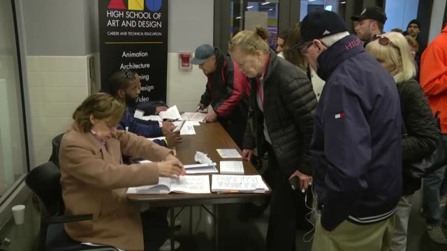 stockvideo's en b-roll-footage met new york residents cast their ballots at robert simon middle school during the 2016 presidential elections in new york city on november 8 2016... - stembus