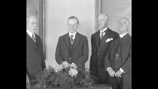 SOT New York Secretary of State Charles Evans Hughes awards former president Calvin Coolidge an honorary membership in the New York Genealogical and...