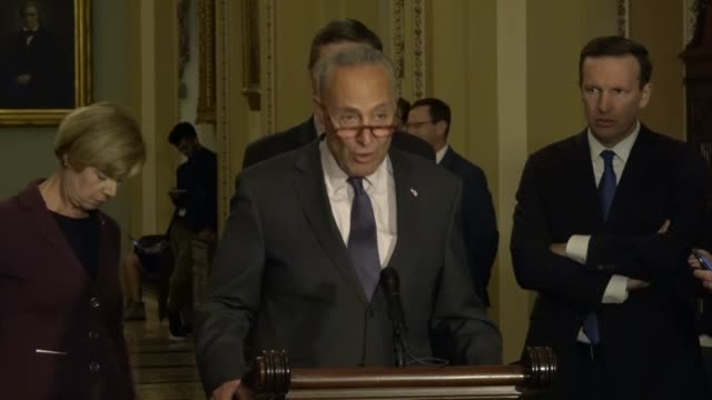 new york senator charles schumer answers a reporter question at a weekly news conference about whether trump nominee congressman john ratcliffe is... - handle stock videos and b-roll footage