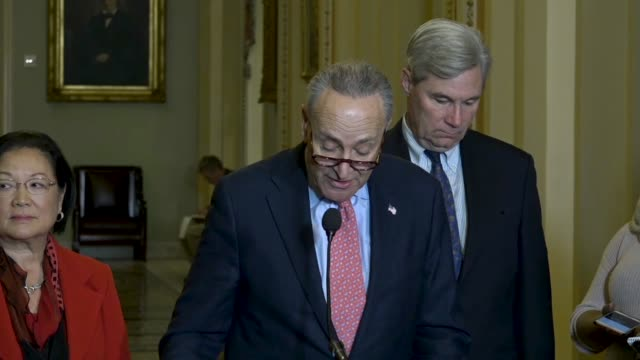 new york senator charles schumer answers questions from reporters at a regular weekly briefing outside the senate chamber schumer says hours after... - department of defense stock videos & royalty-free footage