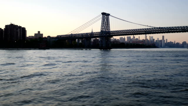 new york skyline: east river view - williamsburg bridge stock videos and b-roll footage