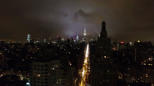 aerial: new york skyline, the empire state building by night - dark stock videos & royalty-free footage