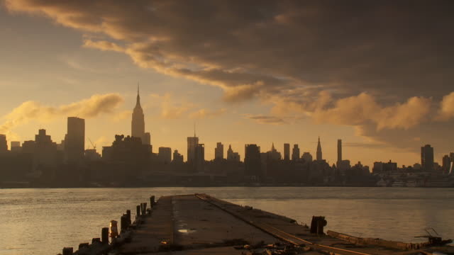 ws new york skyline with steamy clouds and hoboken pier in foreground / new york city, new york, usa - molo video stock e b–roll