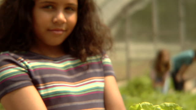 tu, td, cu, usa, new york state, bedford hills, girl (8-9 years) standing in greenhouse, holding lettuce, portrait - 8 9 years stock videos & royalty-free footage