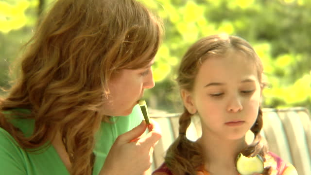 cu, usa, new york state, bedford hills, mother with daughter (6-7 years) eating cucumber slices - 6 7 years stock videos & royalty-free footage