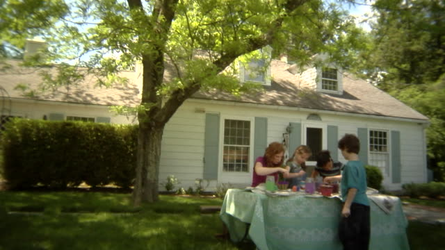 stockvideo's en b-roll-footage met td, ws, usa, new york state, bedford hills, woman with children (6-9 years) painting pots on table at front of house - 6 7 years