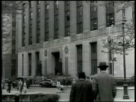 new york state building. door sign: 'athletic commission' int office w/ colonel eddie eagan sitting at desk w/ secretary. colonel eddie eagan working... - 1948 stock videos & royalty-free footage