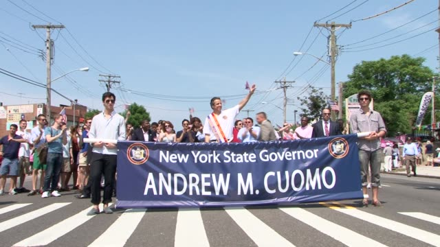 new york state governor andrew m cuomo marches in the 82nd annual little neckdouglaston memorial day parade / governor cuomo marches in memorial day... - andrew cuomo stock videos and b-roll footage