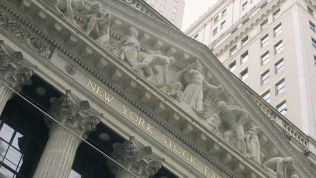 new york stock exchange closeup - financial building stock videos and b-roll footage