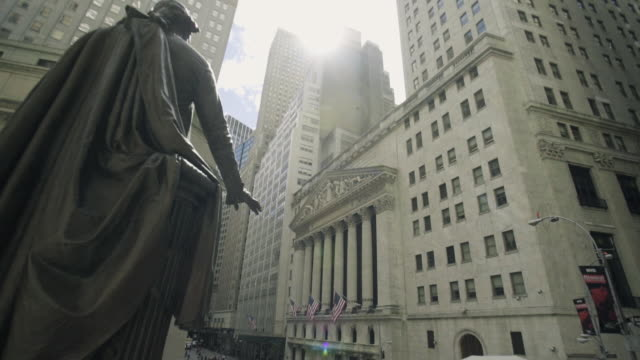 new york stock exchange - panning shot - financial building stock videos and b-roll footage