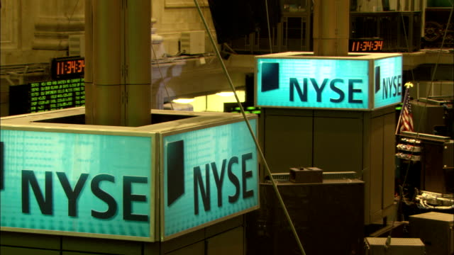 new york stock exchange signs glow on the trading floor. available in hd. - new york stock exchange stock videos & royalty-free footage