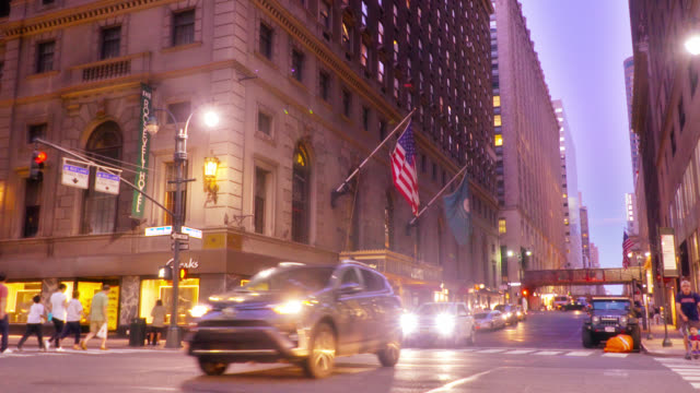 new york street at night. illuminated city lights. american flag - taxi stock videos & royalty-free footage