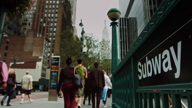 New York Subway Entrance with Distant Empire State Building