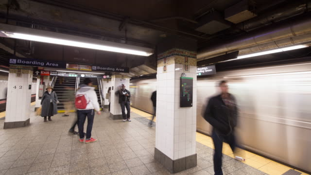 New York subway platforn interior time-lapse with pan