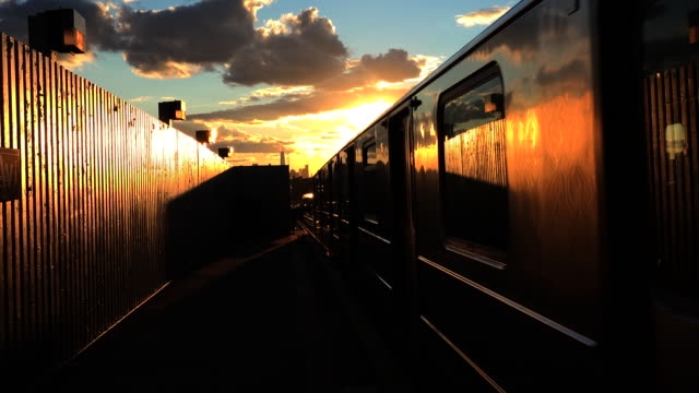 New York Subway Train Coming to Station at Sunset