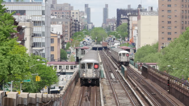 New York subway train on the move between apartment buildings