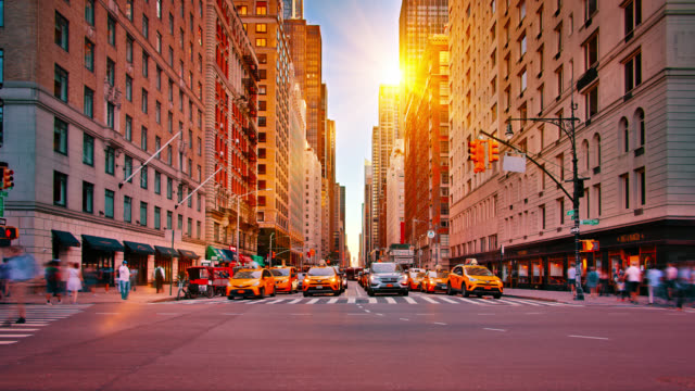 new york. sunrise. classic view. building. traffic. pedestrian. - yellow taxi stock videos & royalty-free footage