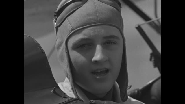 new york superimposed over young pilot / ms preteen pilot edward somers sitting in cockpit states he thinks it's good for boys his age to learn to... - 12 13 år bildbanksvideor och videomaterial från bakom kulisserna