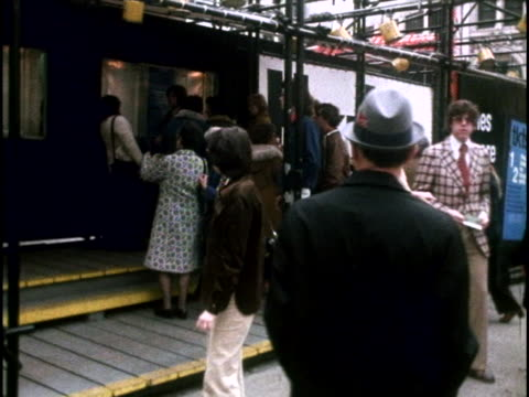 new york theater-goers crowd outside a ticket vendor's window in the 1970s. - broadway manhattan stock videos & royalty-free footage