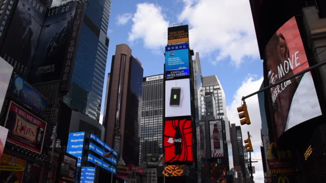 new york, united states: times square and the city lights at night in the downtown district - poster stock videos and b-roll footage