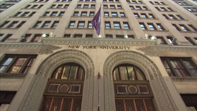 ms td tu new york university sign and flag above the entrance / new york city, new york, usa  - new york university stock videos & royalty-free footage
