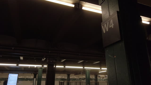 new york city subway platform at west 4th street station isolated closeup detail shot of the west 4th street station signage no people - small group of people stock videos & royalty-free footage