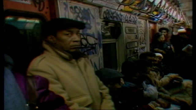 new york vigilante bernhard goetz goes on trial; usa: new york: int police officer down platform stairway on new york subway two policemen on duty in... - crime or recreational drug or prison or legal trial点の映像素材/bロール