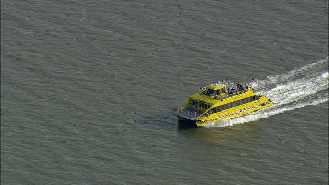 aerial ws new york water taxi in hudson river / new york, usa - water taxi stock videos & royalty-free footage