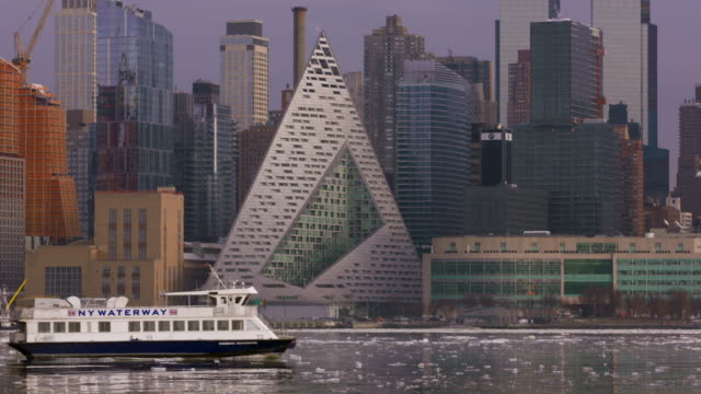 new york water taxi moves through icy hudson river waters passing the west side skyline of manhattan. - water taxi stock videos & royalty-free footage