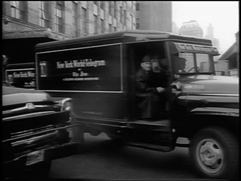 b/w 1963 pan new york world telegram newspaper truck pulling away from building / newsreel - telegram stock videos and b-roll footage