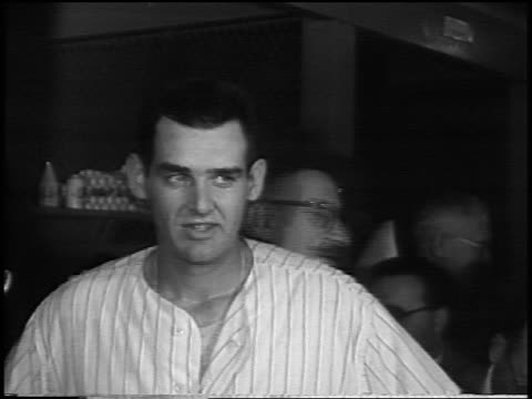 new york yankee don larsen smiling chewing gum in locker room after pitching a 'perfect game' in game 5 of the world series - baseballmannschaft stock-videos und b-roll-filmmaterial
