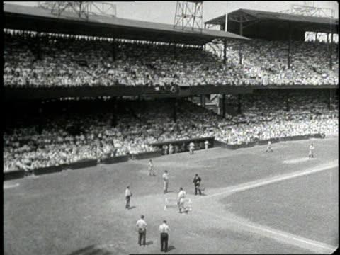 New York Yankee Joe DiMaggio hits a double