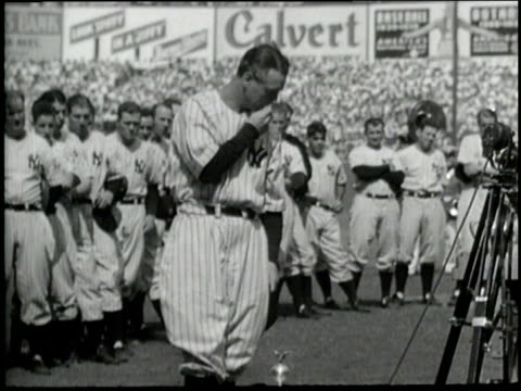 New York Yankee player Lou Gehrig retires as spectators cheer at Yankee Stadium