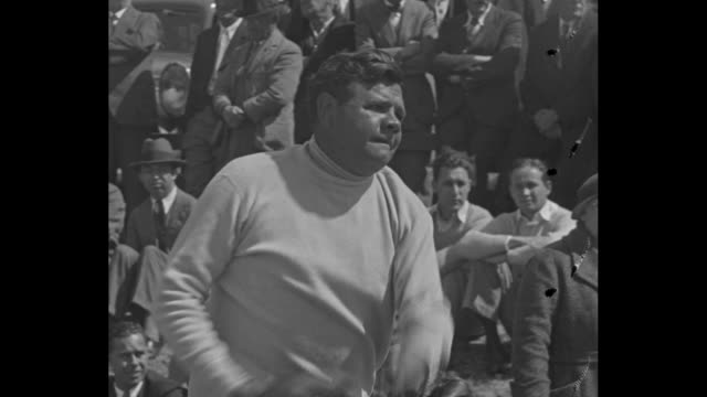 new york yankees baseball team runs out onto field for spring training in st petersburg fl / babe ruth wears white sweater as he throws ball audience... - lou gehrig stock videos & royalty-free footage