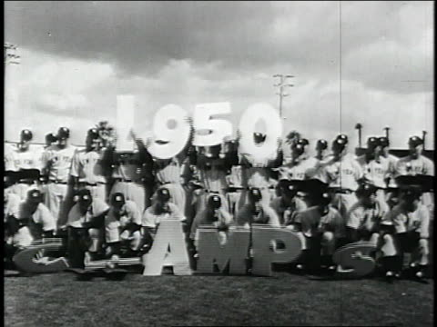 new york yankees hold up a sign that reads '1950 champs' during spring training / united states - 1951点の映像素材/bロール