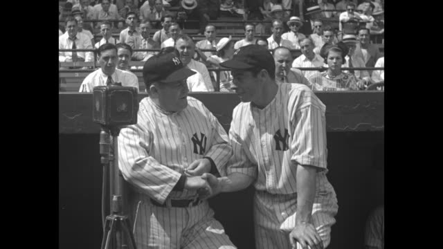 SOT New York Yankees manager Joe McCarthy and player Joe DiMaggio talk together for camera at dugout in Yankee Stadium they banter about DiMaggio's...