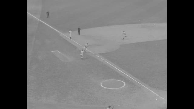 new york yankees pitcher allie reynolds pitches / brooklyn dodgers batter carl furillo at bat hits ball / pan fans cheering furillo and dodgers duke... - new york yankees stock-videos und b-roll-filmmaterial