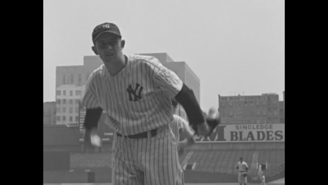 vs new york yankees pitcher atley donald practices pitching at yankee stadium on mound he walks to dugout as fans run to field / note exact day not... - 1939 stock videos & royalty-free footage
